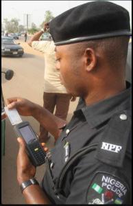 Nigerian policeman caught on camera using POS machine to collect bribe