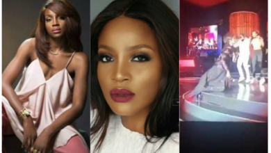 Photo of Seyi Shay reacts to falling on stage during performance at AFRIMA